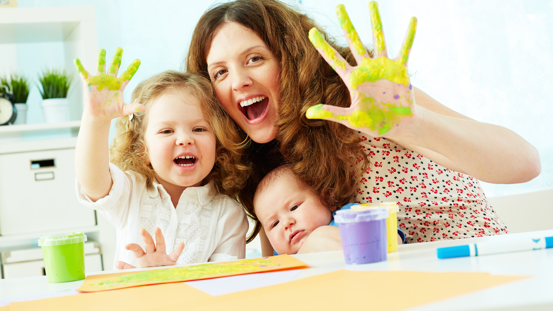 Mother and toddlers, finger painting