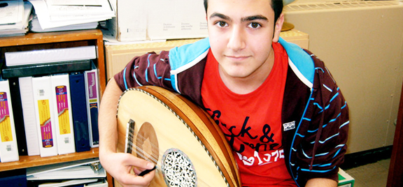 Student playing musical instrument