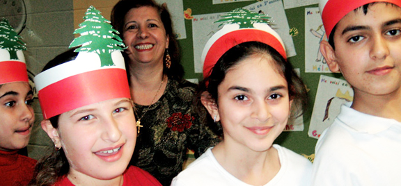 Students with hats representing the colours of Lebanon
