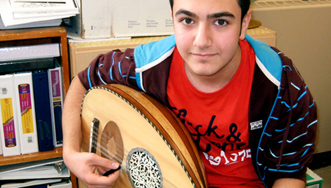 Student with cultural musical instrument